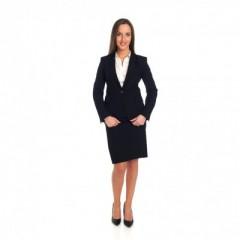 Zwarte rok met bijpassende vest en (wit) hemd